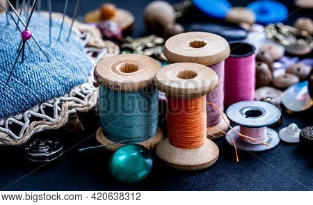 Colorful retro threads on wooden bobbins