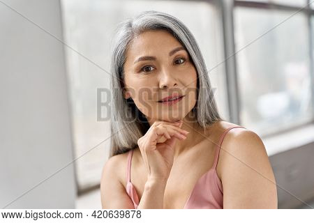 Portrait Of Gorgeous Happy Middle Aged Mature Asian Woman, Senior Older 50s Lady Pampering Touching