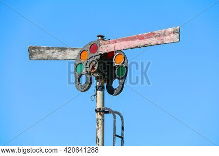 Antique Vintage Retro Old Rusting Railroad Train Tracks Light Signal With Red Orange And Green Lens