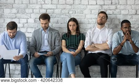 Tired Job Candidates Waiting For Interview Far Too Long