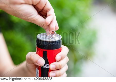 Bangkok, Thailand - 15 May 2021. Opening A Can Of Coca Cola. Coca Cola Drinks Are Produced And Manuf