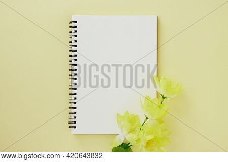 Spiral Notebook Or Spring Notebook In Unlined Type And Light Yellow Flower On Pastel Yellow Minimali