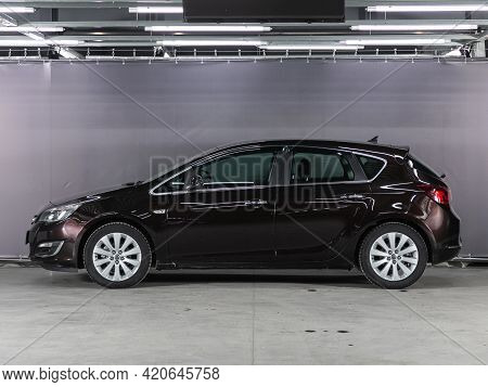 Novosibirsk, Russia - May 16, 2021:  Brown Opel Astra,   Side View. Photography Of A Modern Car On A
