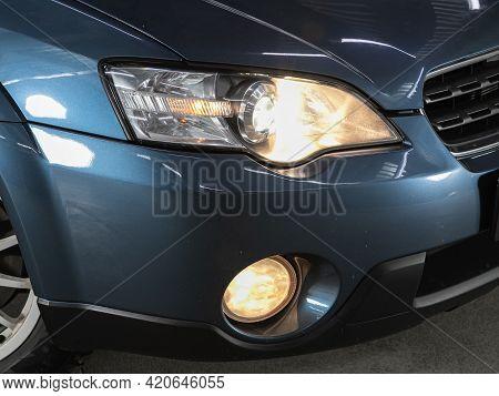 Novosibirsk, Russia - May 16, 2021: Subaru Outback,   Headlight Of A Modern Popular Car Close-up. Sh