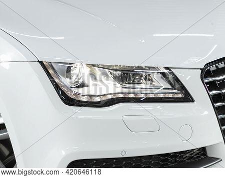 Novosibirsk, Russia - May 16, 2021: Audi A7,   Headlight Of A Modern Popular Car Close-up. Shiny Gla