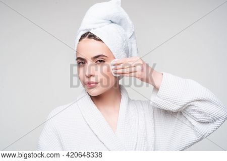Portrait Of Young Beautiful Woman Is Cleaning Her Face From Makeup With Cotton Pads. Skin Care And B