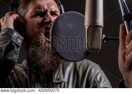 Microphone Concept. Sound Producer Recording Song In A Music Studio. Excited Karaoke.