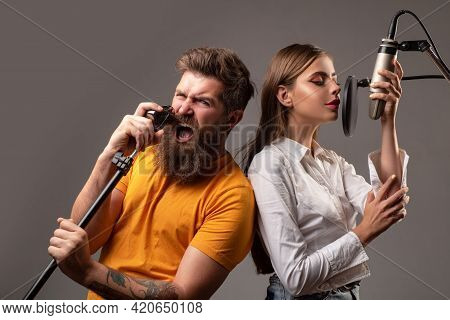 Young Friends With Excited Faces Enjoy Music. Singer Couple Singing Rock. Sound Producer Recording S