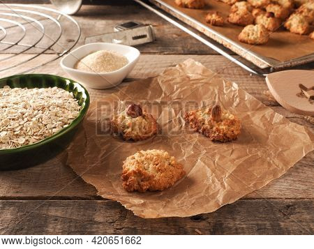 Oatmeal Cookies On Baking Paper With Organic Baking Ingredients, Healthy Food Concept