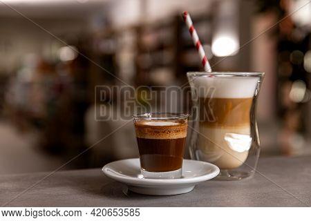 Close Up Shot Of Delicious Hot Coffee Drink Macchiato And Espresso With Steamy Milk