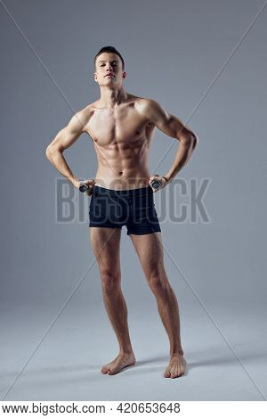 Sporty Man Holding Hands On The Belt In Black Shorts Inflated Body Exercise Fitness