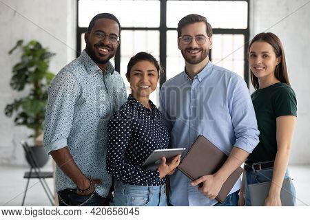 Group Portrait Of Happy Multiethnic United Millennial Team