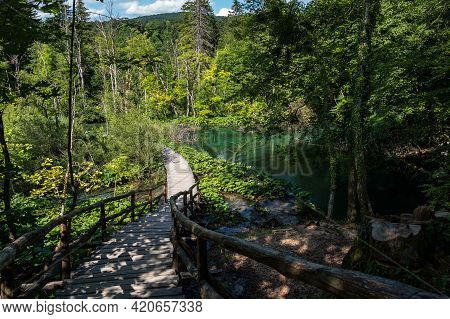 Wooden Path In Plitvice National Park, Croatia. One Of The Oldest And Largest National Parks In Croa