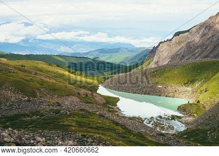 Colorful Green Landscape With Beautiful Turquoise Mountain Lake In Sunlight. Impressive Scenery With