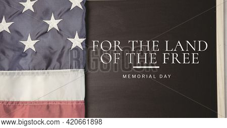 For the land of the free text and american flag, memorial day and patriotism concepts. digitally generated image