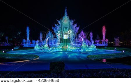 Night View Of Wat Rong Khun (other Name White Temple) With Illuminated Lights. One Of Iconic Tourist