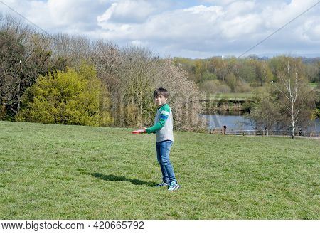 Happy Kid Playing In The Park,child Having Fun Playing Outside In Sunny Day Spring,school Boy Have F