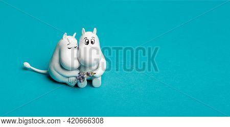 Saint Petersburg - May 6, 2021: Moomins Girlfriend On A Blue Background. Plastic Figurines And Flowe