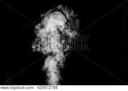 Curly White Steam, Fog Or Smoke Isolated On Black Background. Abstract Mist Or Smog Background