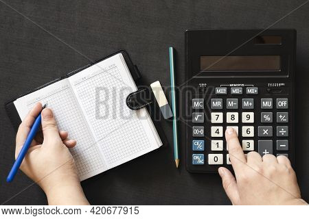 Close Up Business Woman Hand Using Calculator, Notepad And Pen Counting Making. Concept Cost Of  Inc