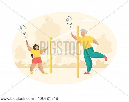 Elderly Woman Plays Badminton With Little Girl. Grandmother With Racket Hits Shuttlecock Towards Joy