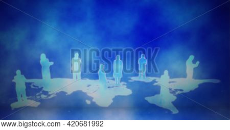 Silhouettes of business people over world map against blue background. global business and technology concept