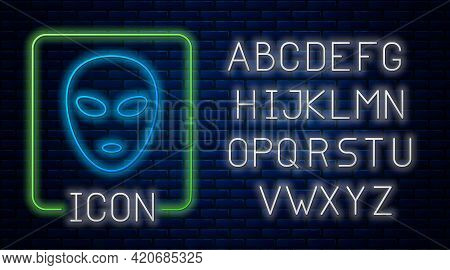 Glowing Neon Alien Icon Isolated On Brick Wall Background. Extraterrestrial Alien Face Or Head Symbo