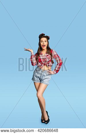 Full Length Of Young Pinup Lady In Retro Outfit Demonstrating Something On Blue Background, Mockup F