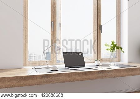 Modern Home Office With Wooden Tabletop, Modern Laptop, City View From The Window, White Coffee Mug