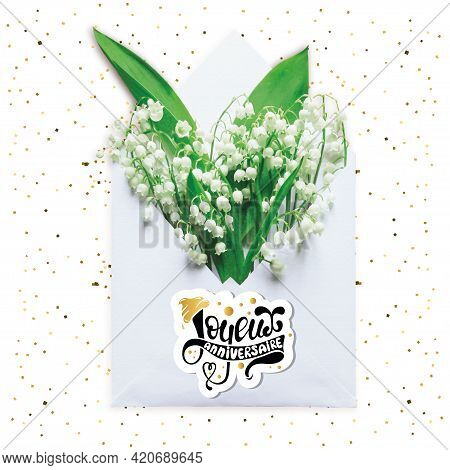Joyeux Anniversaire Happy Birthday In French Greeting Card. Creative Layout Made With Bouquet Of Lil