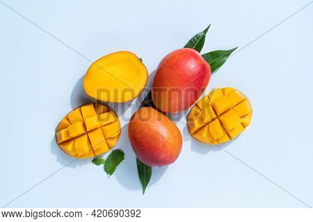 Mango Design Concept. Diced Fresh Mango Fruit On Blue Table Background.