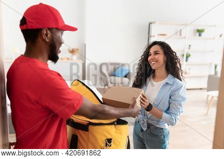 Black Delivery Man Taking Box From Thermal Backpack