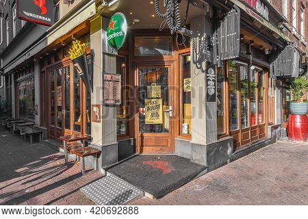 Amsterdam, Netherlands - 20 April, 2021: Exterior Design Of Small Bar With Entrance Door On Corner O
