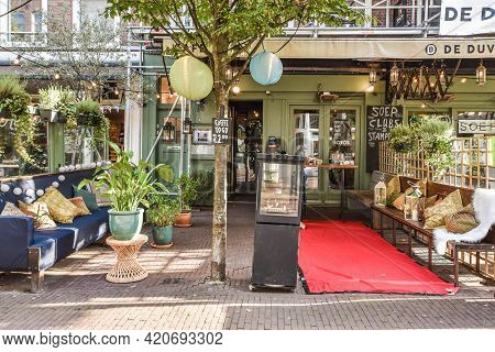 Amsterdam, Netherlands - 20 April, 2021: Retro Style Couches With Cozy Cushions And Red Carpet Place