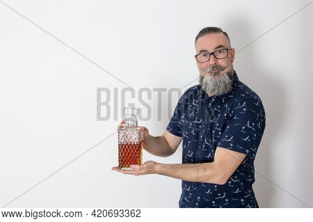 Retro Look Hipster With Big Beard And Glasses, 40-45 Years Old, Caucasian, Holding Old Liquor Bottle