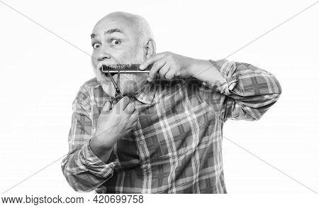 Grooming Beard. Barbershop Concept. Man Senior Bearded Handsome Grandpa Use Tool Styling Beard. Male