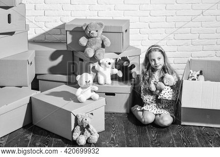 Feeling Good At Home. Playroom Concept. Sweet Home. Girl Child Relaxing After Unpacking Boxes. All S