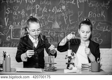 For A Better Tomorrow. Little Girls Genius In School Lab. Science Lab. Science Experiments In Labora
