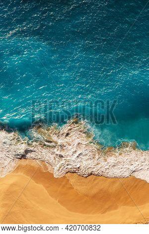 Beautiful Sandy Beach With Blue Sea, Vertical View. Drone View Of Tropical Blue Ocean Beach Nusa Pen