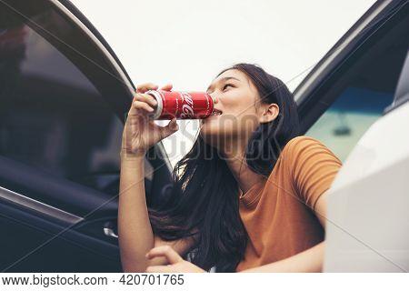 Bangkok, Thailand - May 15, 2021: Beautiful Girl Or Young Woman Enjoy A Vacation Drinking Coca-cola