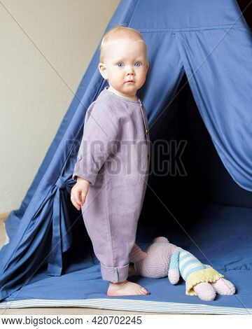 Adorable Blue Eyed Infant Boy In Linen Purple Romper Looking At Camera While Spending Time In Kids R