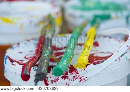 Paints, Multi-colored. Bright Juicy Colors, Sticks Of Different Colors. Palette Of Colors, A Bucket