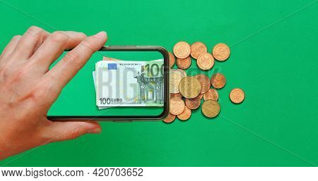 Money Paper Euro Banknotes On The Background Of A Smartphone Screen, Cents On A Green Background, Th