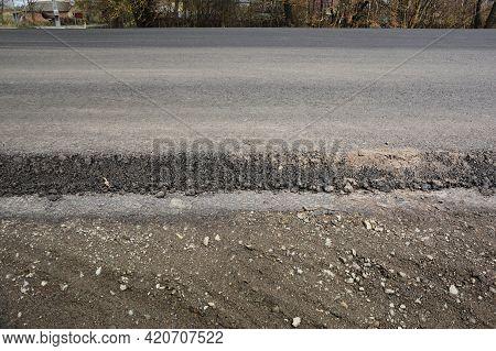 Asphalt Road, Highway, Driveway Construction And Renovation. A Close-up Of An Asphalt Pavement Struc