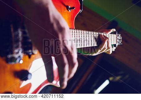 Man musician playing guitar. Closeup of rock and roll musician on playing music. Musician playing music. Rock music musician playing guitar