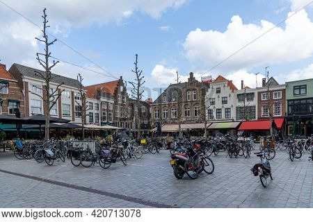 Town Square In The Dutch City Of Goes With Many Buildings And Parked Bicycles