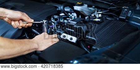 Mechanic Working With Wrench On Vehicle Engine In Car Service. Maintenance And Repair. Banner Copy S