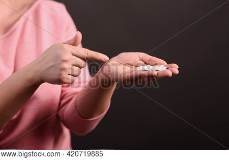 Tablets In The Palm Of Your Hand. The Woman Points To The Handful Of Pills In Her Hand. Close-up. On