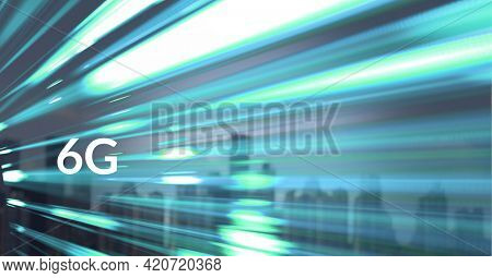 Composition of 6g text over glowing blue light trails and cityscape. global connection, networks, technology, data processing and digital interface concept digitally generated image.