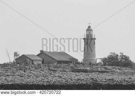 Lighthouse And Lighthouse Keepers House On The Coast In Cyprus In Bw